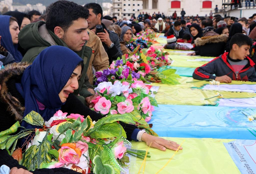 Syrian Kurds mourn in Afrin during a funeral for fighters from the People's Protection Units (YPG) militia and the Women's Protection Units (YPJ)