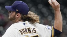 Burnes delivers with arm, bat as Brewers trounce Cubs 7-0