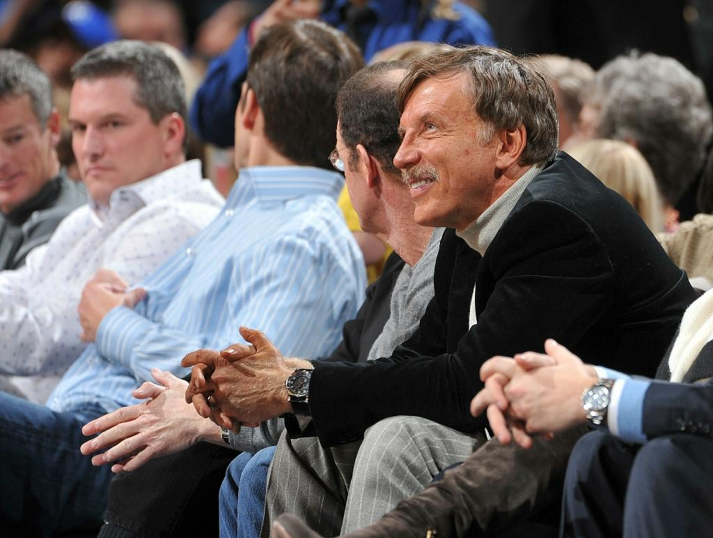 Stanley Kroenke, watching a game played by his Denver Nuggets, says he knows his wine and won't mess with tradition