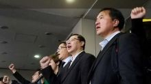 Hong Kong protest leaders appear in court smiling after surprise summons