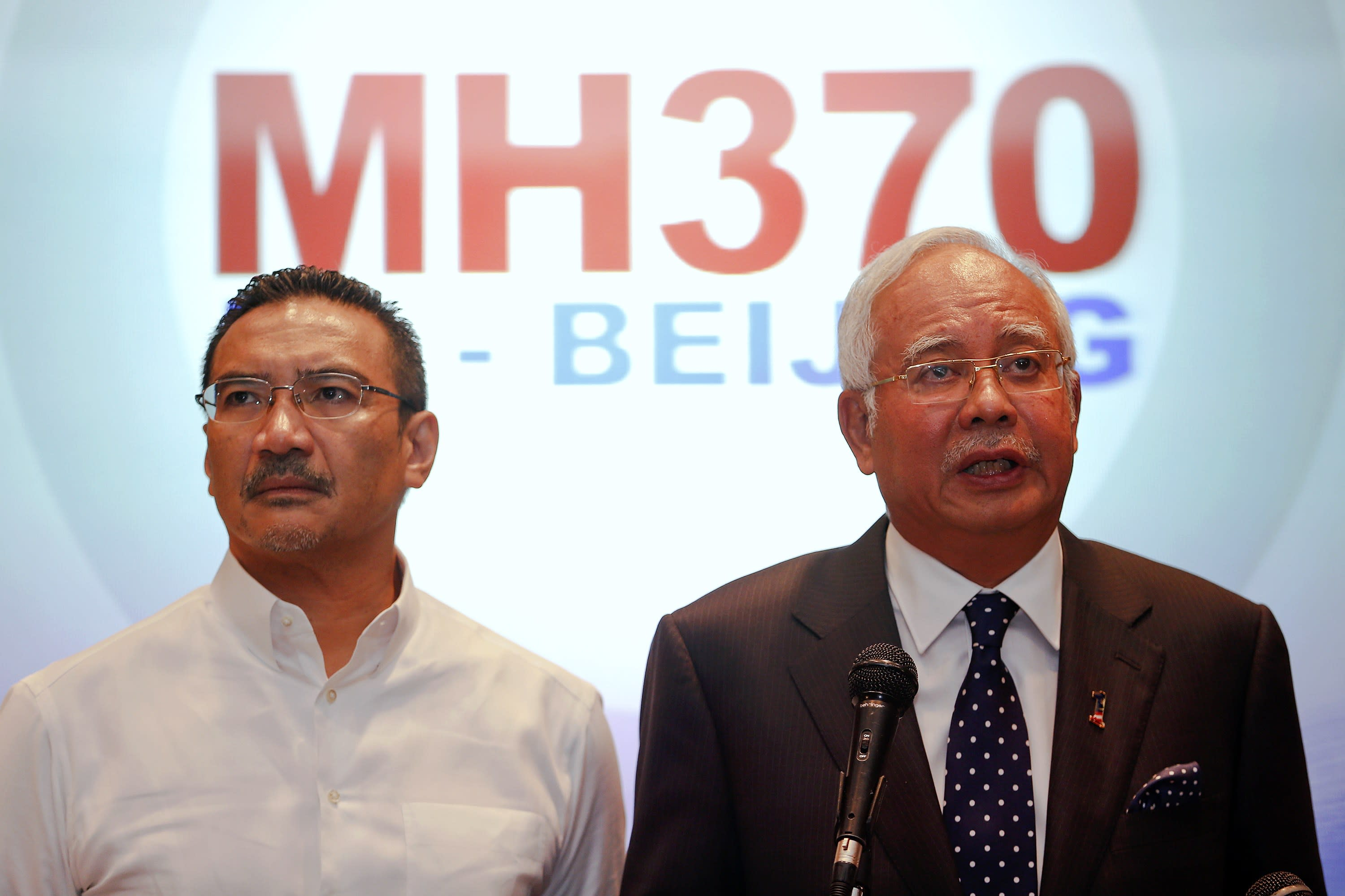 REFILE WITH ADDITIONAL INFORMATION Malaysian Prime Minister Najib Razak (R) addresses reporters as Transport Minister Hishammuddin Hussein stands by him, at the Kuala Lumpur International Airport March 15, 2014. Najib said on Saturday that the movements of the missing Malaysia Airlines Flight MH370 were consistent with a deliberate act by someone who turned the jet back across Malaysia and onwards to the west. REUTERS/Damir Sagolj (MALAYSIA - Tags: DISASTER TRANSPORT POLITICS TPX IMAGES OF THE DAY)