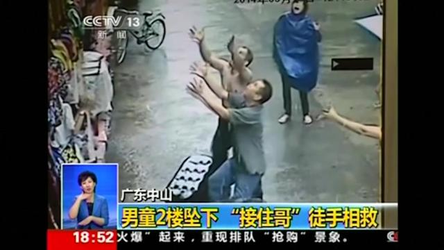 Man catches child who fell from second story window in China