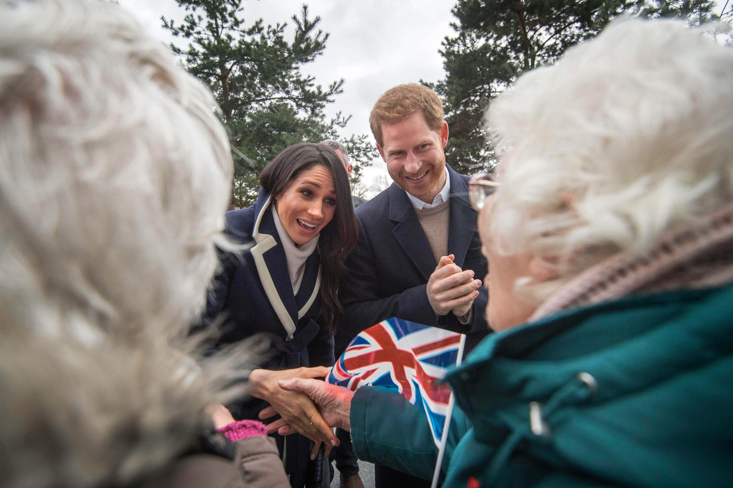 Prince Harry and Meghan Markle talk to sisters Jean Dickinson and Irene Gould on a walkabout during a visit to Millennium Point in Birmingham, as part of the latest leg in the regional tours the couple are undertaking in the run-up to their May wedding.