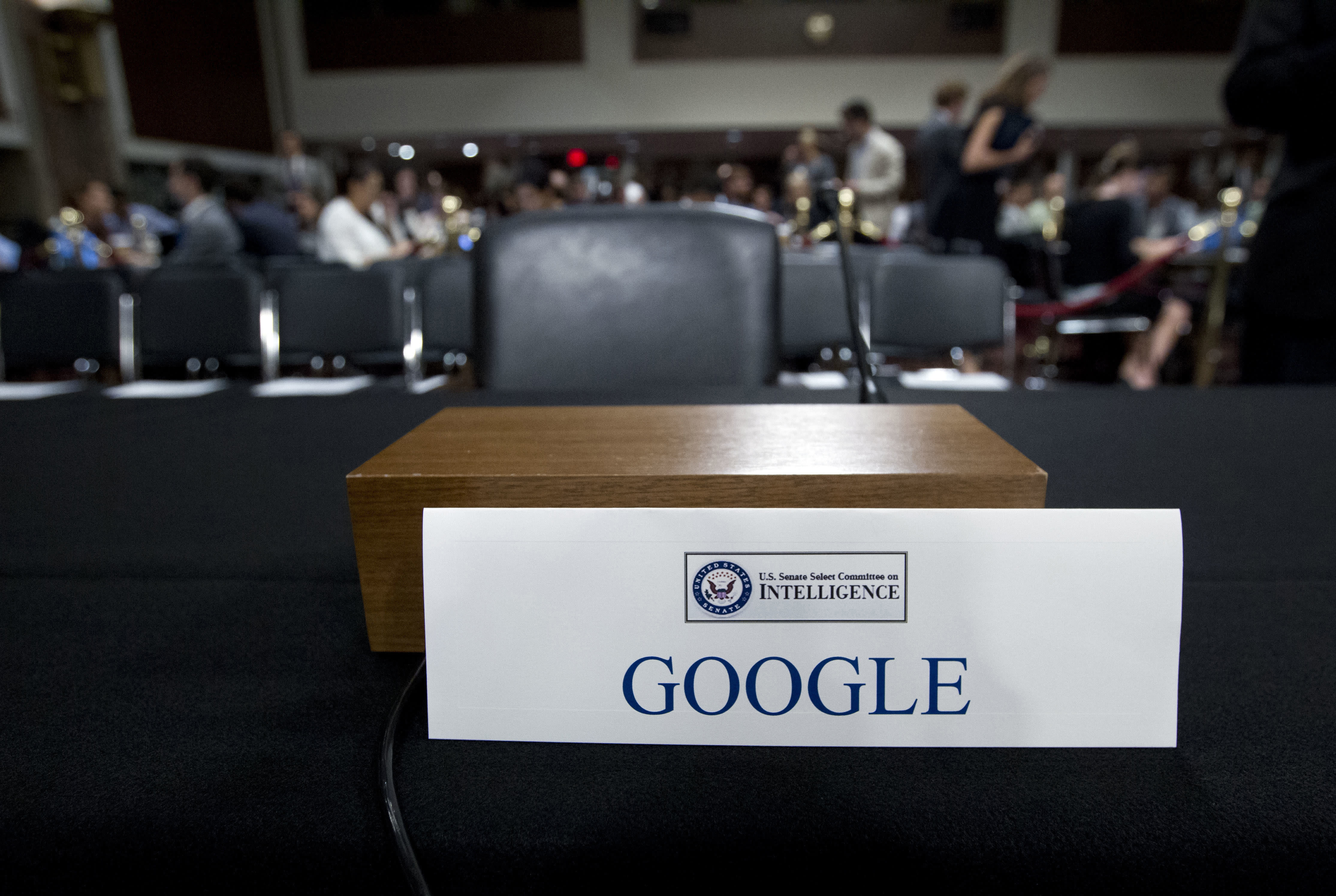 "FILE - This Sept. 5, 2018, file photo shows an empty chair reserved for Google's parent Alphabet, which refused to send its top executive, as Facebook COO Sheryl Sandberg and Twitter CEO Jack Dorsey testify before the Senate Intelligence Committee hearing on Capitol Hill in Washington. A year ago, Shoshana Zuboff dropped an intellectual bomb on the technology industry. In a 700-page book, the Harvard scholar skewered tech giants like Facebook and Google with a damning phrase: ""surveillance capitalism."" (AP Photo/Jose Luis Magana, File)"
