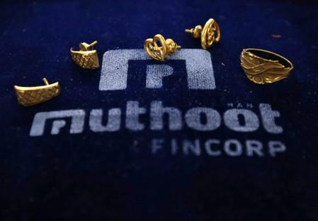 Gold ornaments are pictured inside a Muthoot Fincorp branch in Mumbai