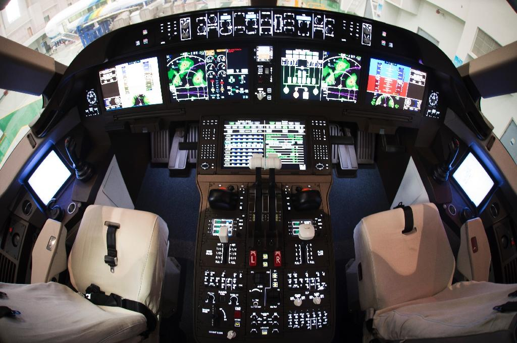 A mock cockpit of a C919 passenger plane is seen at the research centre of Commercial Aircraft Corp. of China (COMAC), in Shanghai, in 2014 (AFP Photo/Johannes Eisele)
