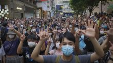 UK to open citizenship path to Hong Kongers from January