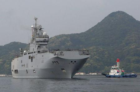 French amphibious assault ship Mistral (L) arrives at Japan Maritime Self-Defense Force's Sasebo naval base in Sasebo, Nagasaki prefecture, Japan April 29, 2017, ahead of joint exercises with U.S., British and Japanese forces in waters off Guam. REUTERS/Nobuhiro Kubo