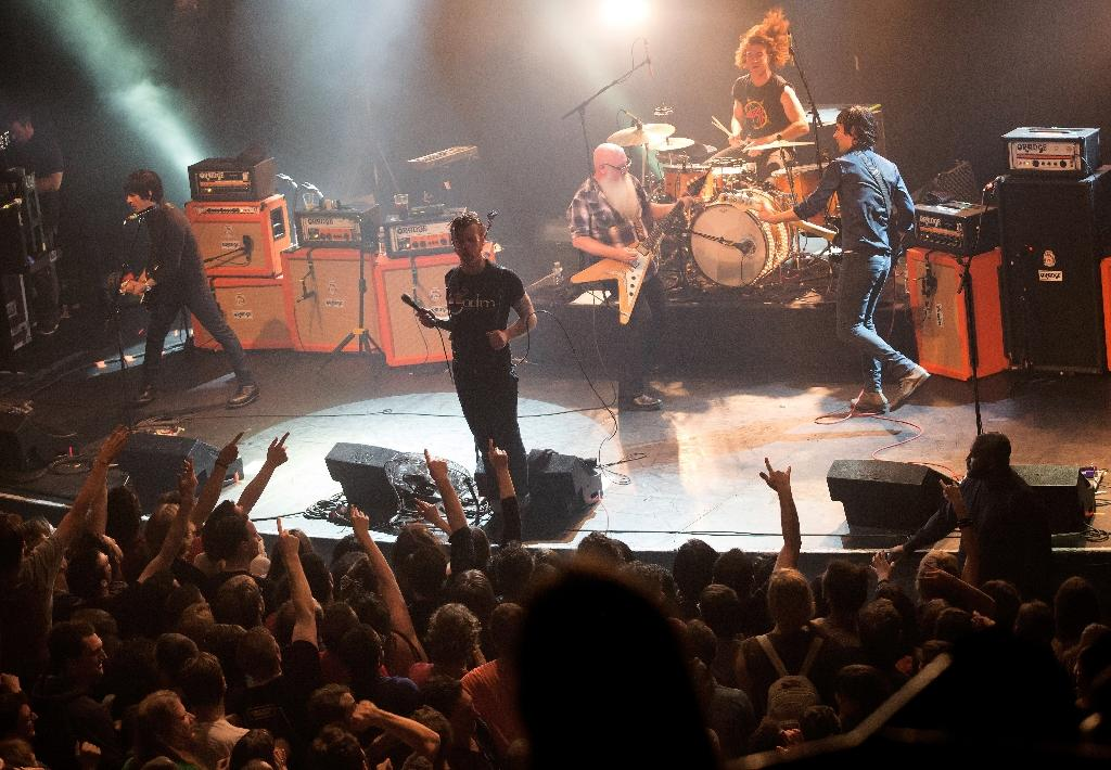 Eagles of Death Metal on stage on November 13, 2015 at the Bataclan in Paris, shortly before the attacks (AFP Photo/Marion Ruszniewski)