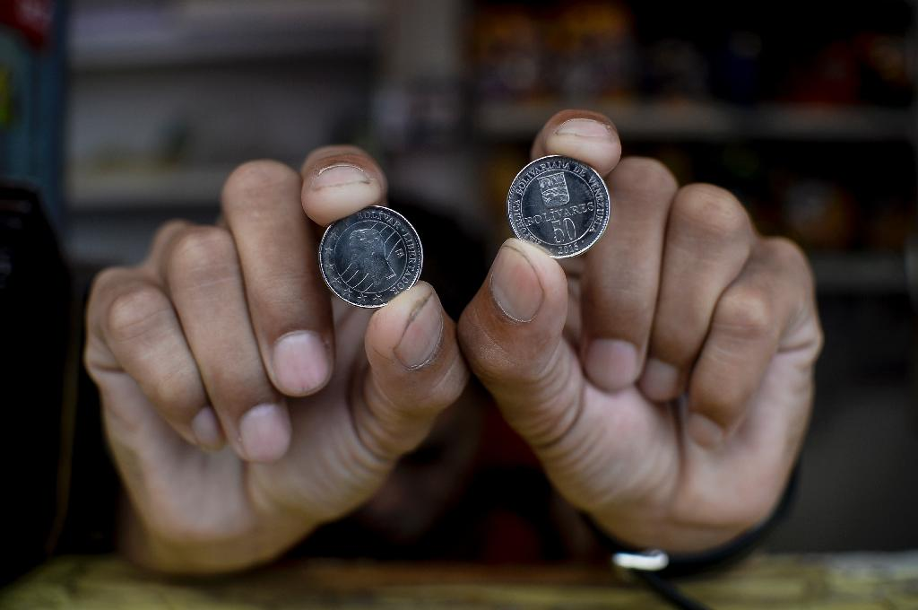Although Venezuelans received new coins (pictured), vendors have yet to see the new bank notes that are worth 500 bolivars, despite the central bank's claim that several shipments have arrived (AFP Photo/Federico Parra)