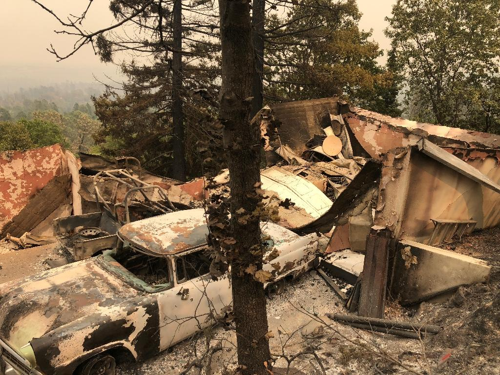The remains of an antique car collection lie in a fire-devastated neighborhood near Redding, California (AFP Photo/Gianrigo MARLETTA)