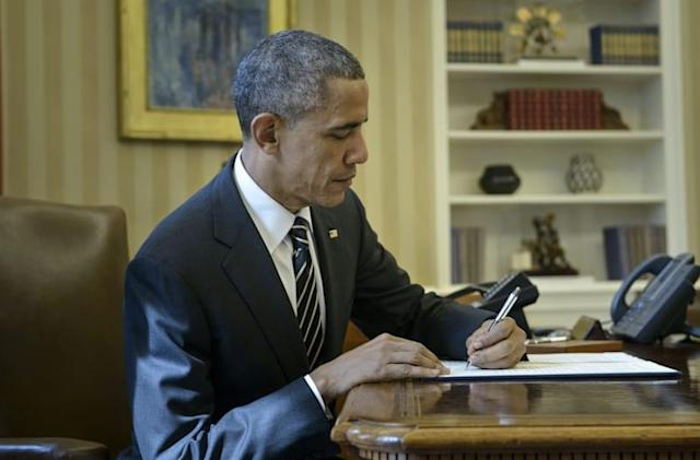 Obama orders 40 percent cut in federal government's carbon emissions