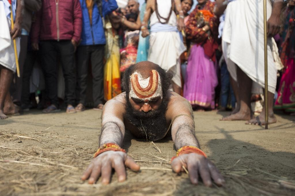 Swami's body collects dust and grime before he arrives at the confluence (AFP Photo/Xavier GALIANA)