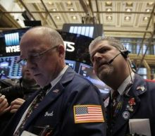 Wall Street flat as losses in financials offset healthcare gains