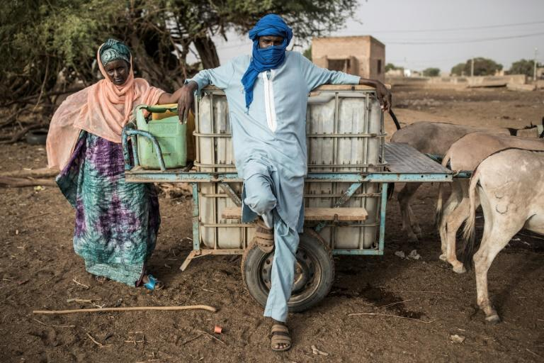 Months of government restrictions on movement designed to curb the coronavirus have coincided with the hardest months of the dry season (AFP Photo/JOHN WESSELS)