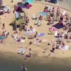Brits crowd beaches despite warnings of COVID-19 resurgence