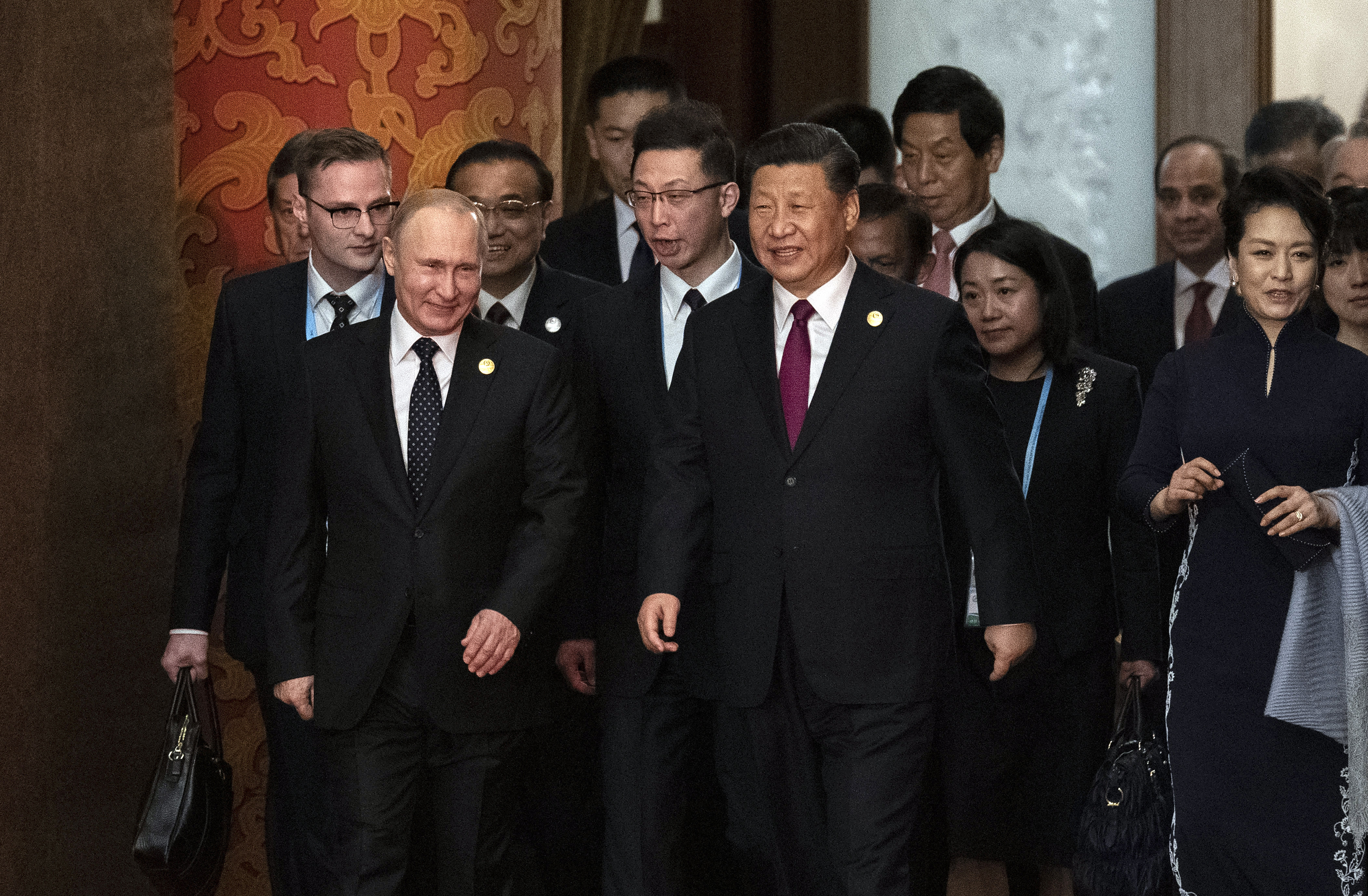 FILE - In this April 26, 2019, file photo, Russian President Vladimir Putin, front left, and Chinese Premier Xi Jinping, front center, arrive for the welcome banquet at the Belt and Road Forum at the Great Hall of the People in Beijing. A Russian naval task force has arrived in the northern Chinese port of Qingdao ahead of joint naval exercises that reinforce the growing bond between Beijing and Moscow. (Nicolas Asfouri/Pool Photo via AP, File)