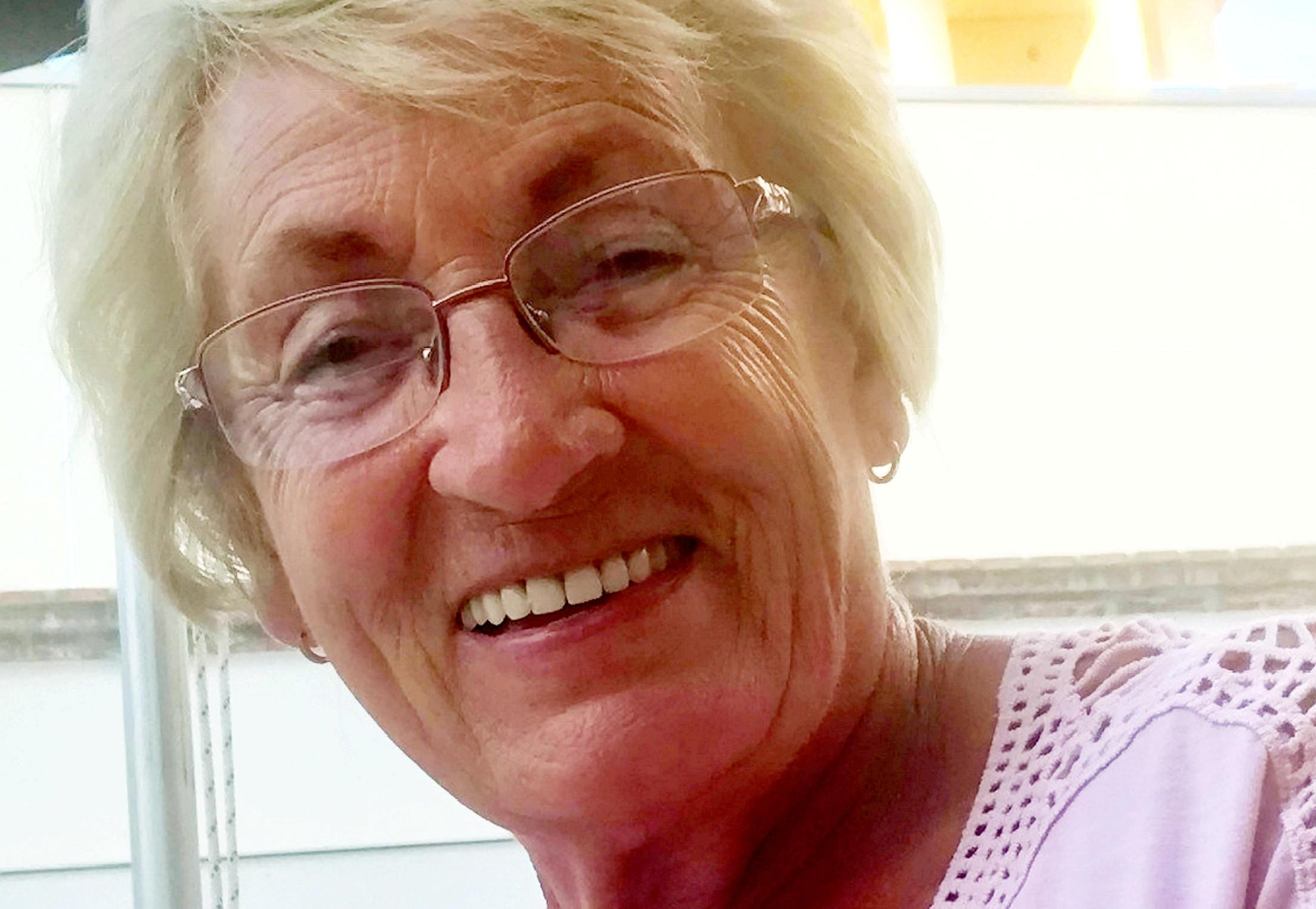 Grandmother killed by police car while crossing road on mobility scooter