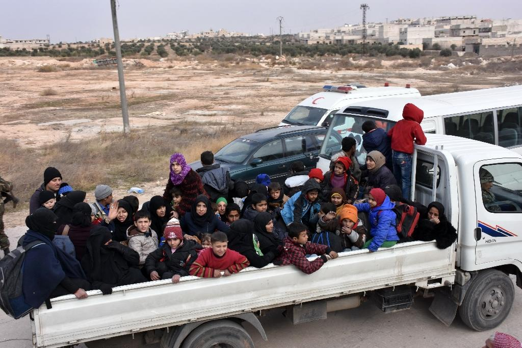 Syrian families escape the conflict in eastern districts of Aleppo, on November 29, 2016