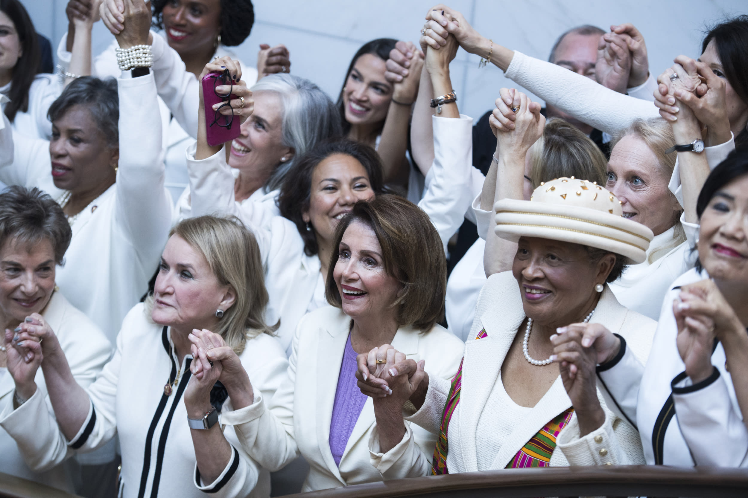 UNITED STATES - FEBRUARY 05: First row from left, Reps. Jan Schakowsky, D-Ill., Sylvia Garcia, D-Texas, Speaker Nancy Pelosi, D-Calif., and Alma Adams, D-N.C., pose for a group photo of House Democrats in the Capitol Visitor Center, who plan to wear 'suffragette white' to the State of the Union address to show solidarity for women's agendas on Tuesday, February 5, 2019. (Photo By Tom Williams/CQ Roll Call)