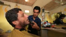 Shaves at barber's, corpses in streets as Islamic State retreats in Mosul