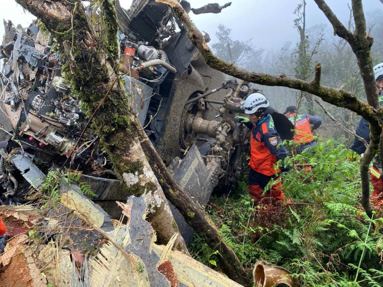 Rescuers searching for survivors after a military Black Hawk helicopter smashed into mountains in Yilan county near Taipei, killing the island's top military chief, Shen Yi-ming (AFP Photo/Handout)