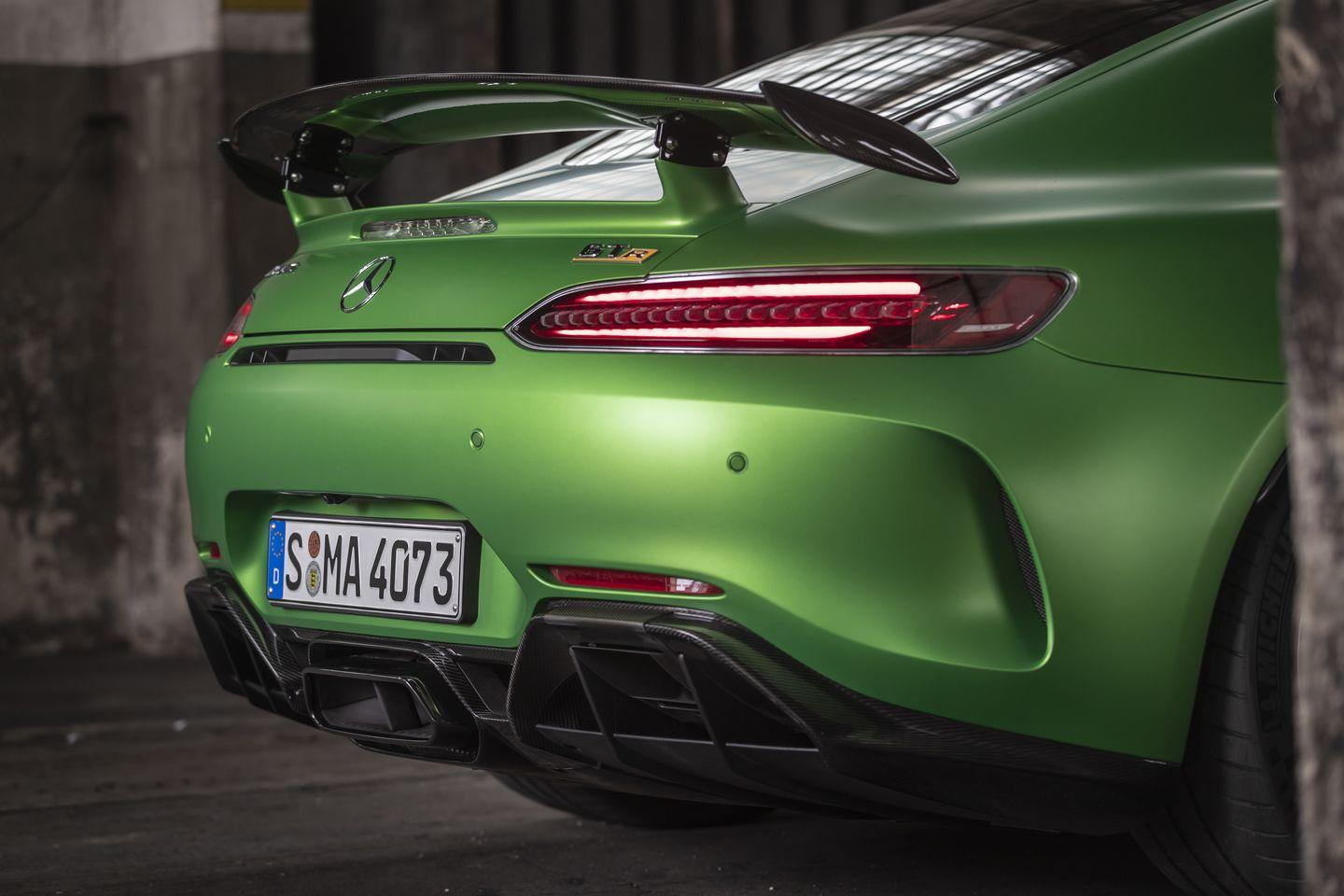 """<p>The GT R's center-exit exhaust is evocative on its own. But not many people notice the two additional square pipes that exit out of the diffuser on either side. These square pipes open up only when you switch the exhaust system to 'race' mode. <a href=""""https://www.ebay.com/itm/2018-Mercedes-Benz-AMG-GTR-Coupe/153575238247?hash=item23c1cc2a67:g:RWcAAOSwQHBdNLbW"""" rel=""""nofollow noopener"""" target=""""_blank"""" data-ylk=""""slk:Here's a lightly used GT R"""" class=""""link rapid-noclick-resp"""">Here's a lightly used GT R</a> on eBay you can own right now. </p>"""