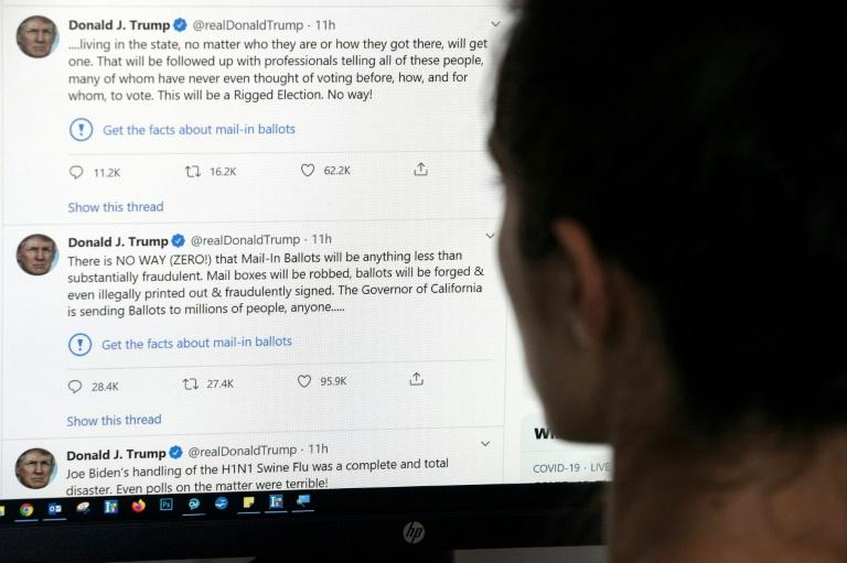 Twitter for the first time slapped a warning label on tweets from President Donald Trump, prompting an angry response from the US leader who vowed to regulate or shut down social media platforms (AFP Photo/-)