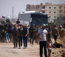 Syria rebels evacuate 'cradle' of uprising as Israel strikes north