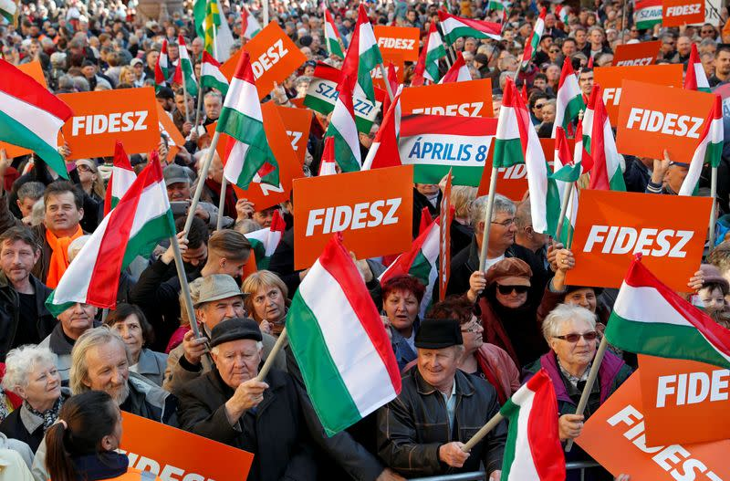 FILE PHOTO: Supporters of Hungarian Prime Minister Viktor Orban are seen before his campaign closing rally in Szekesfehervar