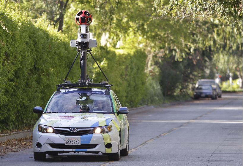 "FILE - In this Oct. 27, 2010 file photo, an employee drives a Google vehicle around Palo Alto, Calif. Internet giant Google's Street View project has raised privacy concerns in several countries. Attorneys suing Google for enabling its camera-carrying vehicles to collect emails and Internet passwords while photographing neighborhoods for the search giant's popular ""Street View"" maps look forward to resuming their case now that a U.S. appeals court has ruled in their favor. The U.S. Court of Appeals in San Francisco said Tuesday that Google went far beyond listening to accessible radio communication when they drew information from inside people's homes. (AP Photo/Paul Sakuma, File)"