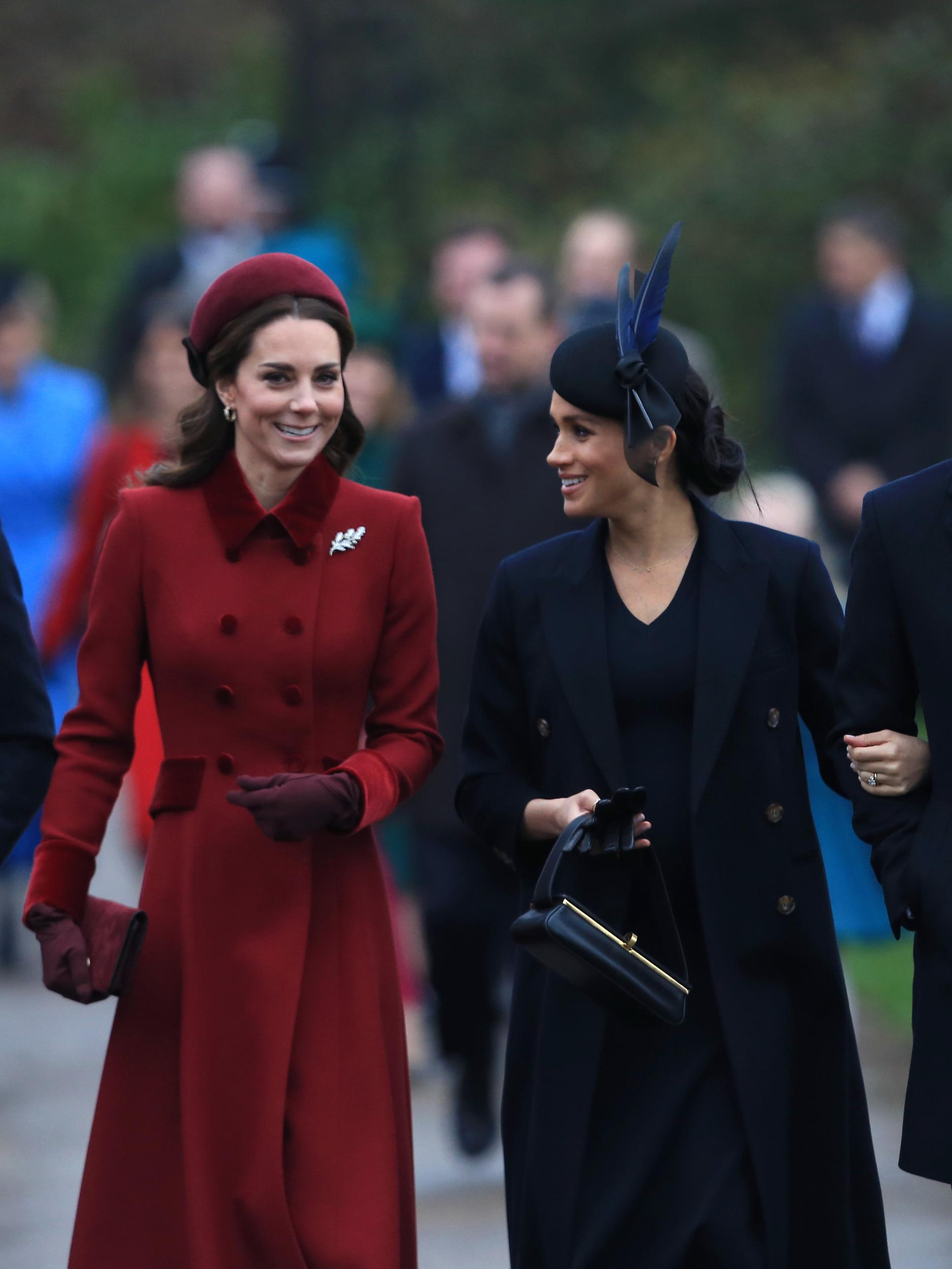 KING'S LYNN, ENGLAND - DECEMBER 25: Catherine, Duchess of Cambridge and Meghan, Duchess of Sussex arrive to attend Christmas Day Church service at Church of St Mary Magdalene on the Sandringham estate on December 25, 2018 in King's Lynn, England. (Photo by Stephen Pond/Getty Images)