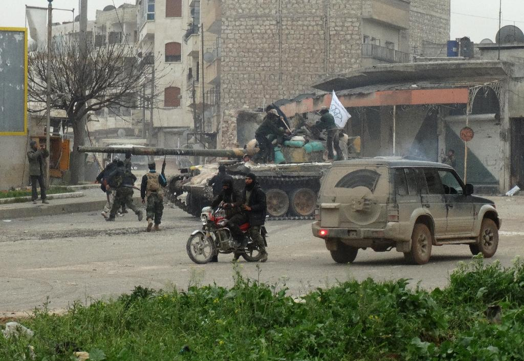 A coalition made up of Al-Nusra Front, the official Syrian affiliate of Al-Qaeda, and several Islamist factions seized the city of Idlib on March 28, 2015 (AFP Photo/Mohamad Zeen)