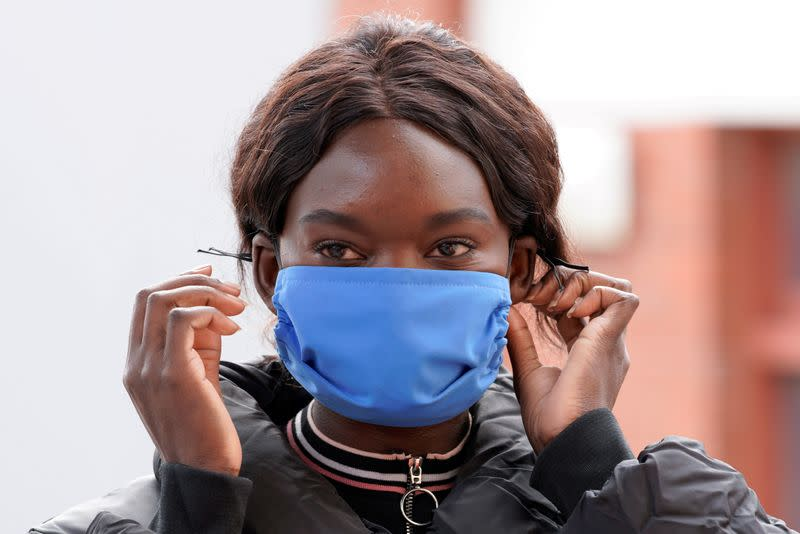 FILE PHOTO: A worker models a face mask made to help curb the spread of the coronavirus disease (COVID-19) in Melbourne