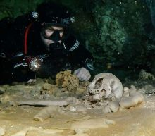 Archaeologists find fossils, Mayan relics in giant underwater cave in Mexico