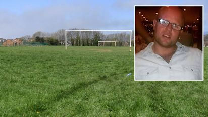 Footballer 'drove into young rival fans after defeat'