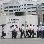 Japan looks to ease virus emergency ahead of Olympics