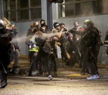 Portland protest declared unlawful assembly after fire set