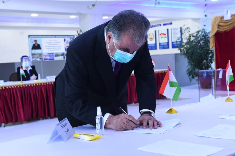 Tajikistan's President Rakhmon visits a polling station during the presidential election in Dushanbe