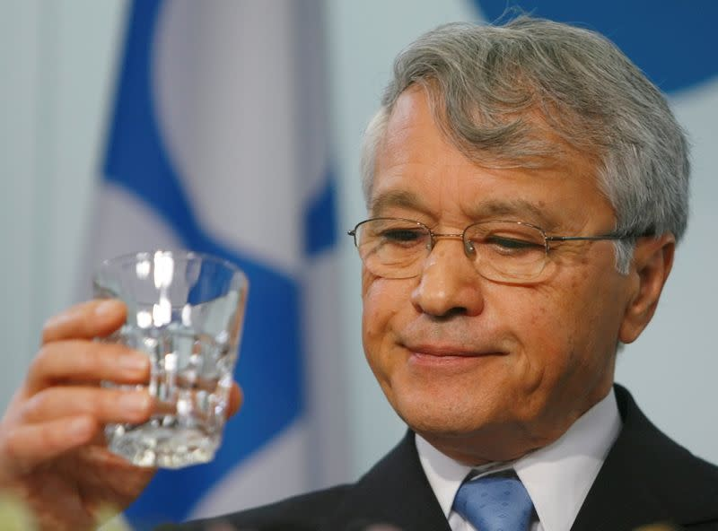FILE PHOTO: Algerian Energy minister and OPEC president Khelil holds a glass during a news conference in the OPEC headquarters after a meeting of OPEC oil ministers in Vienna