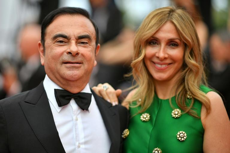 Carole and Carlos Ghosn at Cannes film festival in happier times (AFP Photo/LOIC VENANCE)
