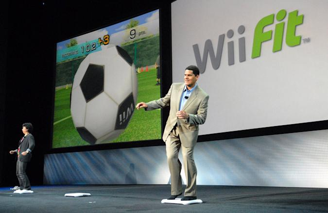 SANTA MONICA, CA - JULY 11:  Nintendo of America President Reggie Fils-Aime (right) competes against legendary Nintendo video game designer Shigeru Miyamoto in Wii Fit, an upcoming motion-controlled video game that features agility, balance and fitness challenges during Nintendo's media briefing July 11, 2007 in Santa Monica, California. (Photo by Bob Riha, Jr./WireImage)