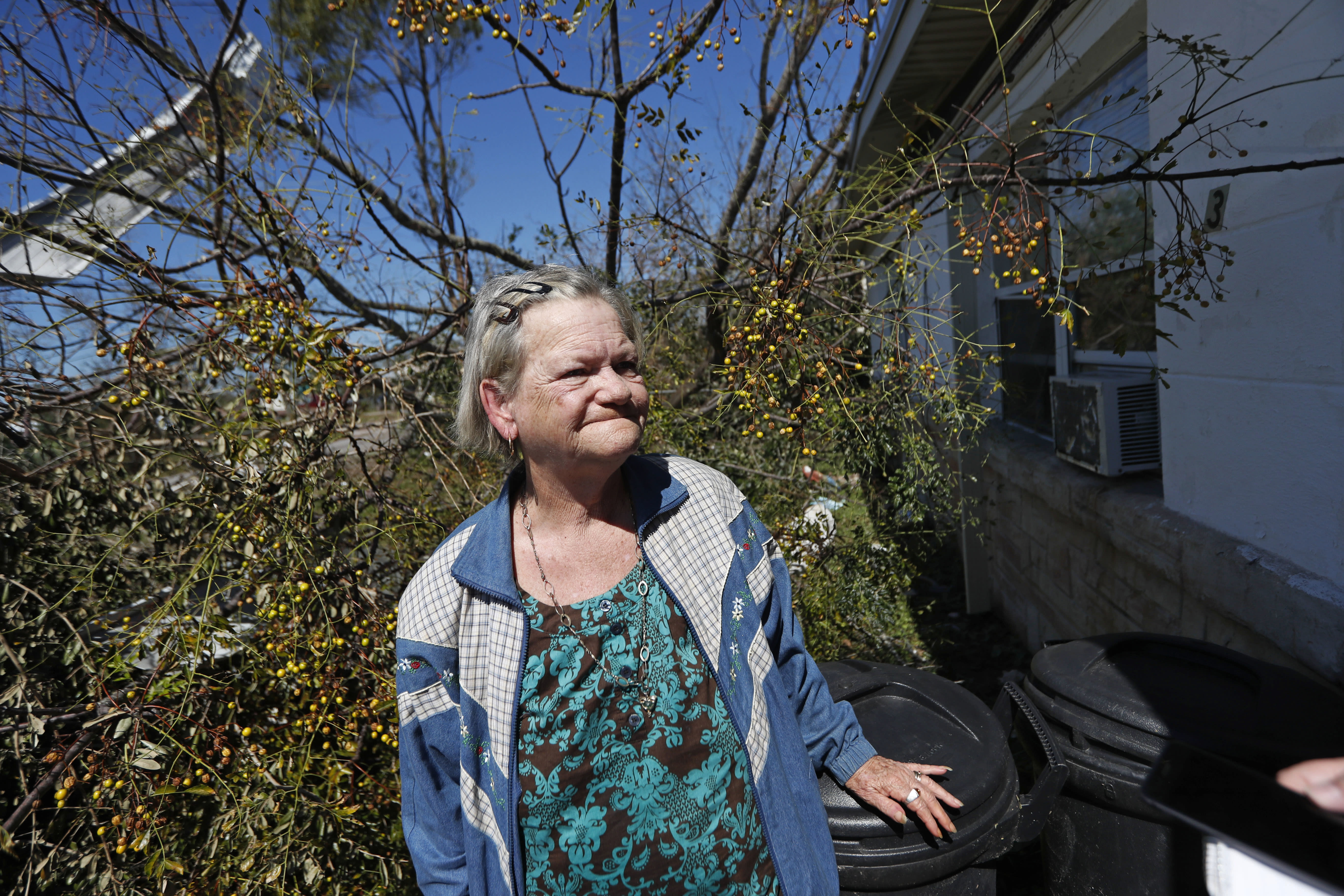 Mary Frances Parrish reacts outside her heavily damaged home, in the aftermath of Hurricane Michael in Panama City, Fla., Saturday, Oct. 13, 2018. She didn't leave the storm because her car was broken down, she didn't have a place to go and if she did she didn't have the money for it. She is caring for her terminally ill son who lives with her. (AP Photo/Gerald Herbert)