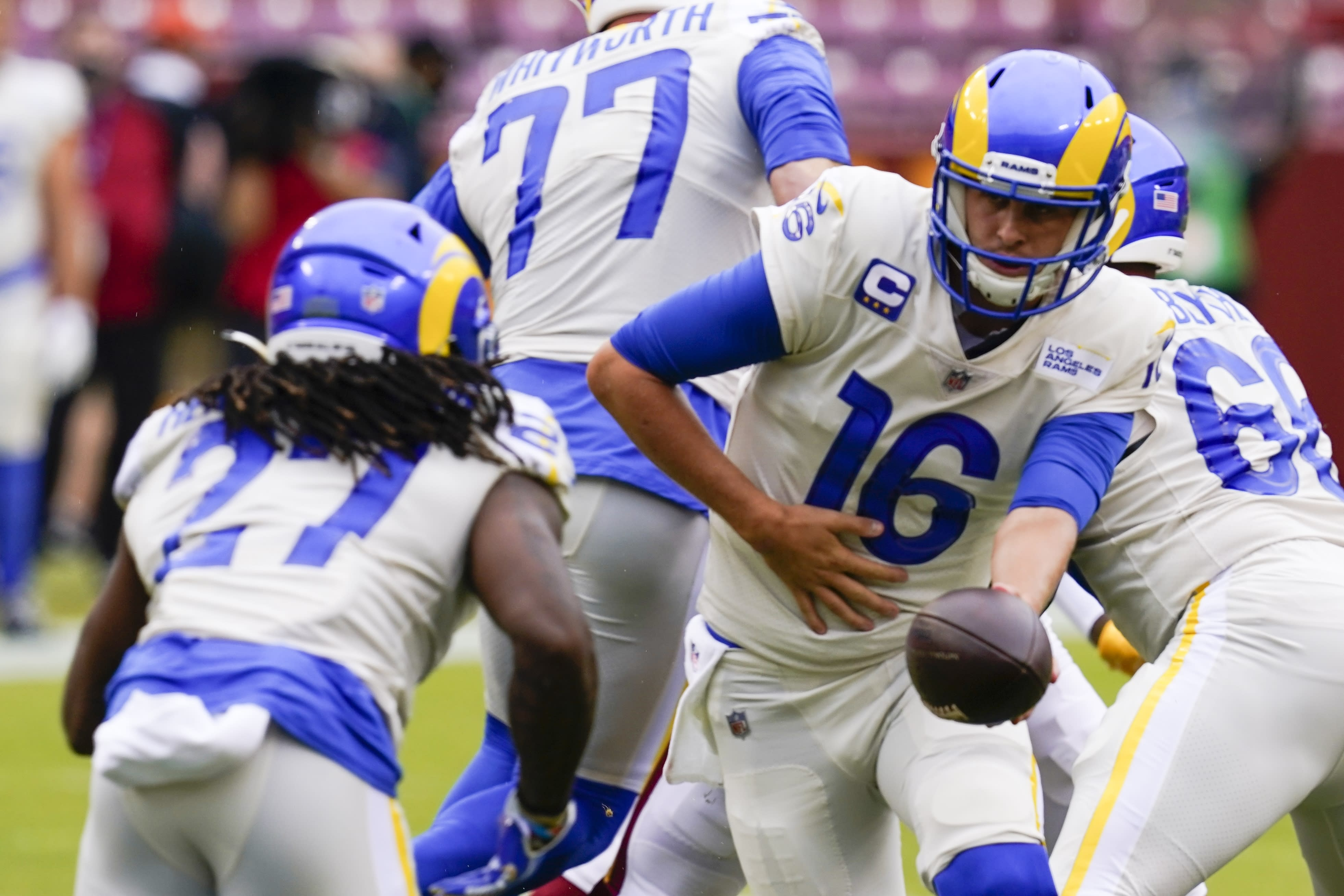 Los Angeles Rams' Jared Goff (16) hands off to Darrell Henderson (27) during the first half of an NFL football game against the Washington Football Team Sunday, Oct. 11, 2020, in Landover, Md. (AP Photo/Steve Helber)
