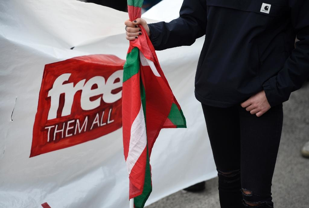 A woman holds a Basque flag as people gather outside the Martutene prison in San Sebastian, Spain during a demonstration demanding the release of prisoners affiliated to the Basque separatist group ETA on December 31, 2017