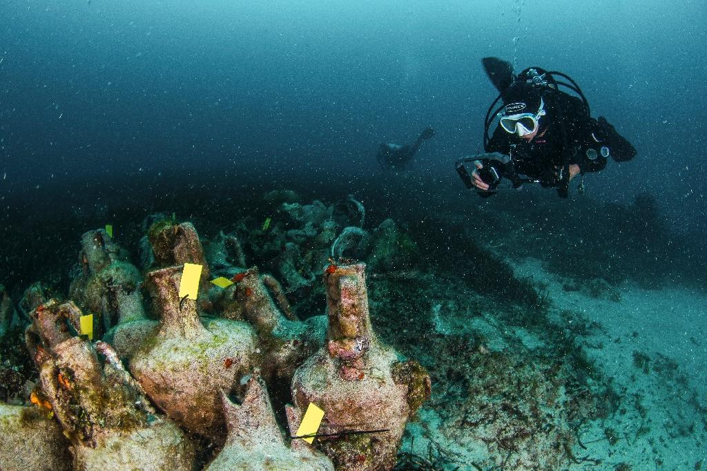 Divers explore the ruins of an ancient shipwreck on the Aegean island of Alonissos -- Greece is seeking to open to visitors some of its vast heritage of ancient shipwrecks, to aid the economies of nearby islands