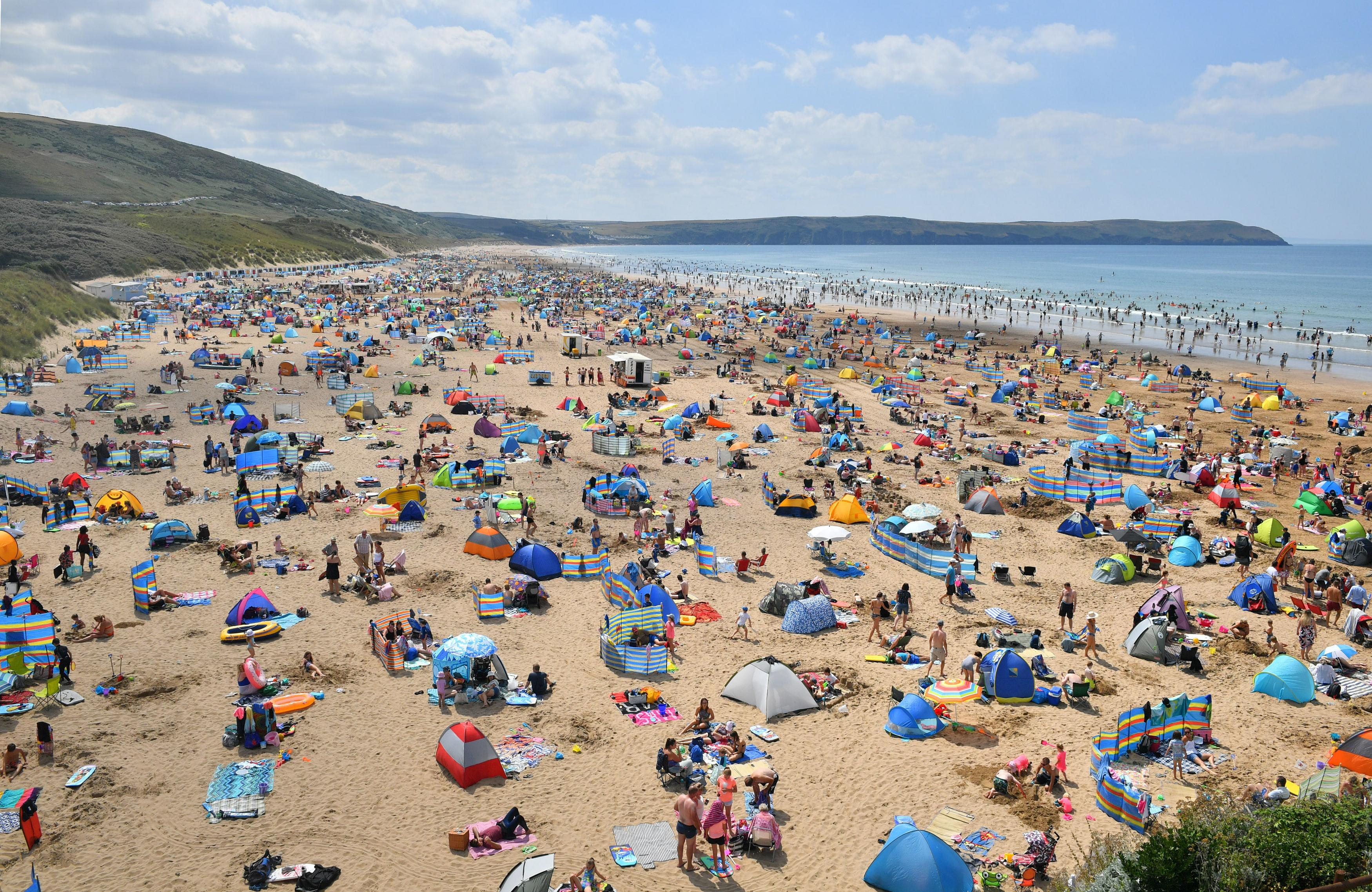 South-west England is 'full to capacity' following influx of tourists during heatwave, say police