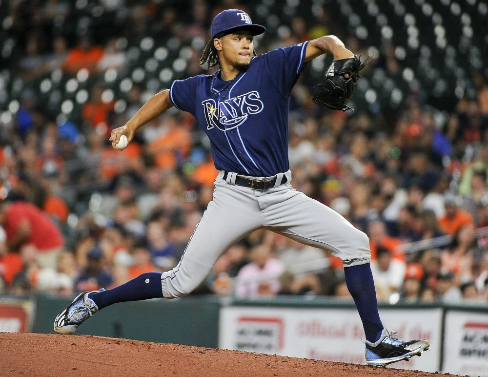 One day after beating the Astros, Tampa Bay Rays ace Chris Archer battled the team's mascot Orbit in a water balloon battle. (AP)