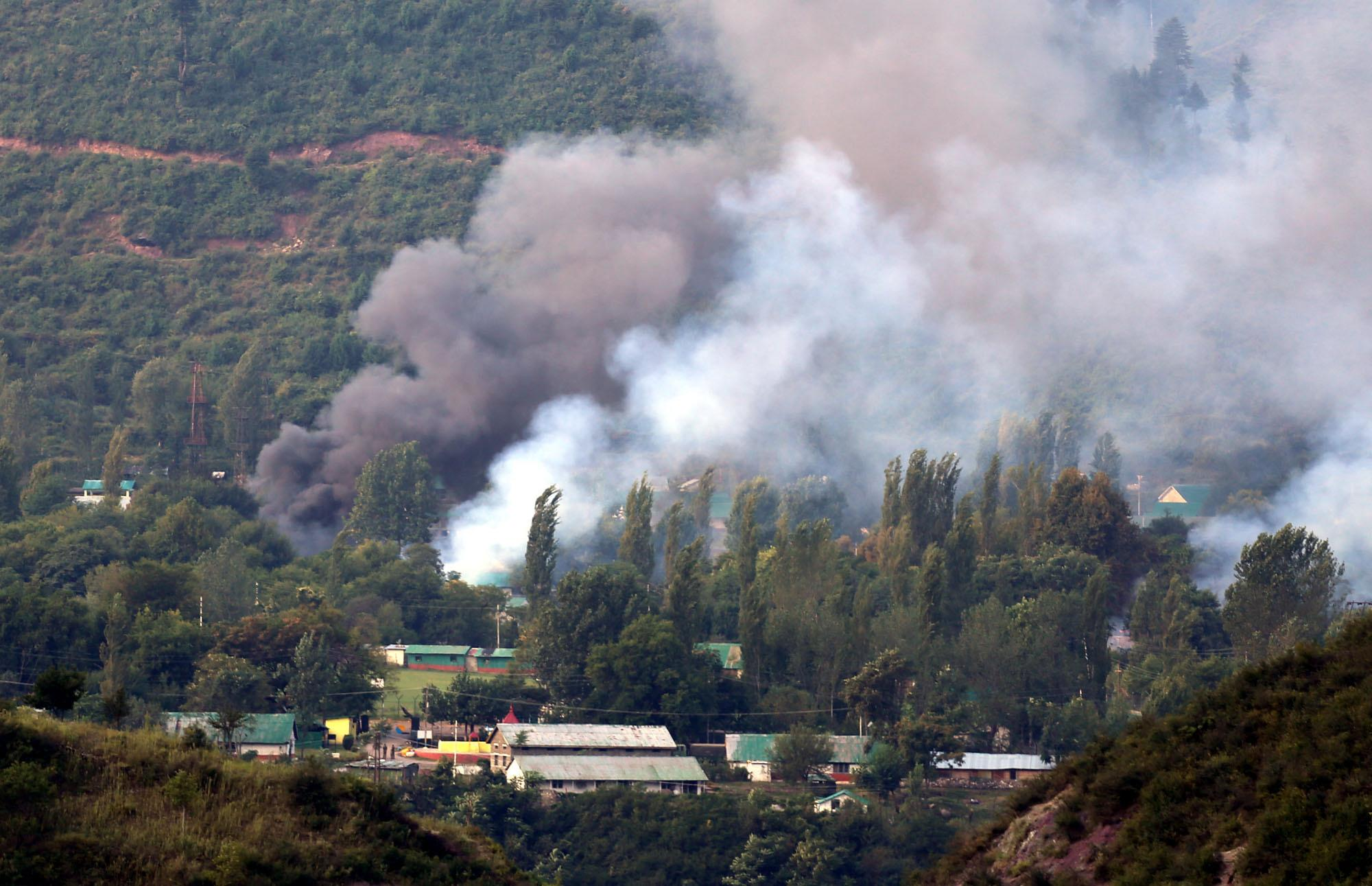 <p>Smoke rises from the army base which was attacked by militants in the town of Uri, west of Srinagar. Photo – Getty </p>