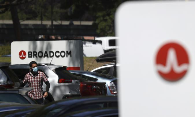 SAN JOSE, CALIFORNIA - JUNE 03: An employee walks through the parking lot at a Broadcom office on June 03, 2021 in San Jose, California. Chipmaker Broadcom will report second quarter earnings today after the closing bell and is expected to beat analyst expectations. (Photo by Justin Sullivan/Getty Images)